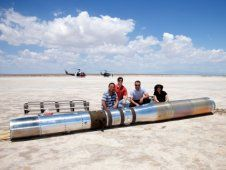 The recovering team poses for a photo<br /> with the payload before loading the<br /> instrument in a pair of U.S. Army<br /> Helicopters and returning to base.<br /> (NASA/MSFC)&nbsp;&nbsp;<br /> <a href='http://www.nasa.gov/topics/solarsystem/features/hic-briefing-supplement.html' class='bbc_url' title='External link' rel='nofollow external'>� View all photos/full captions</a><br /> <a href='http://www.nasa.gov/topics/solarsystem/features/hic-briefing-materials.html' class='bbc_url' title='External link' rel='nofollow external'>� Media briefing photos/videos</a>